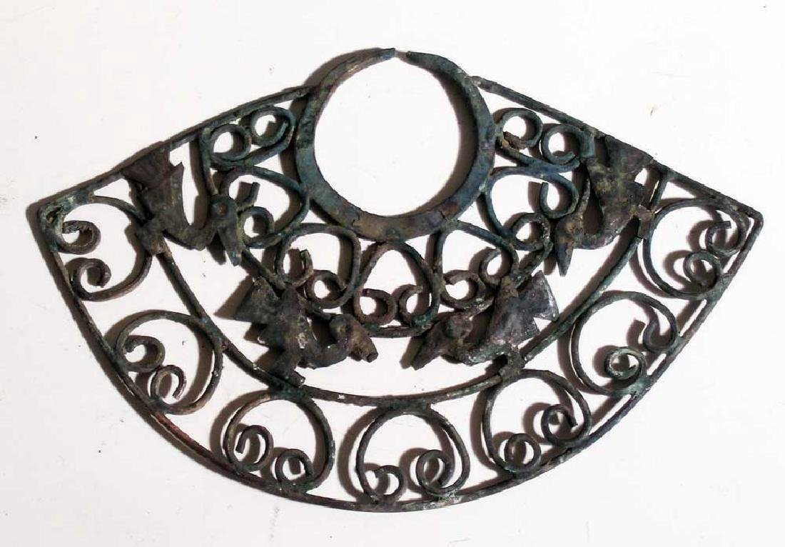 A large Pre-Columbian silver nose ornament