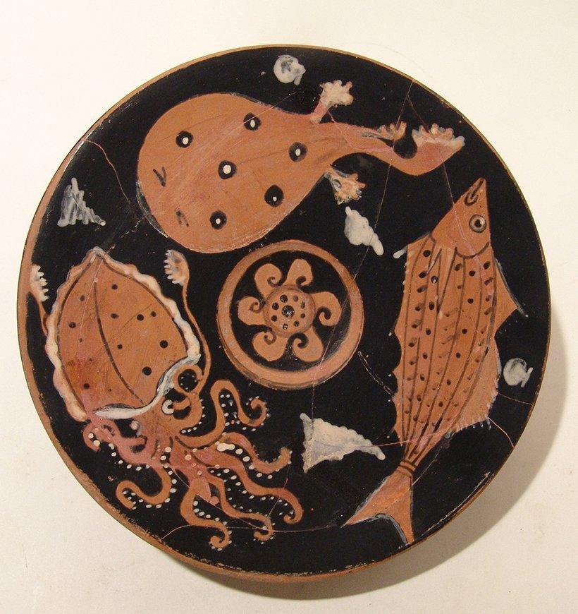 A fantastic Greek red-figure fish plate, Campania