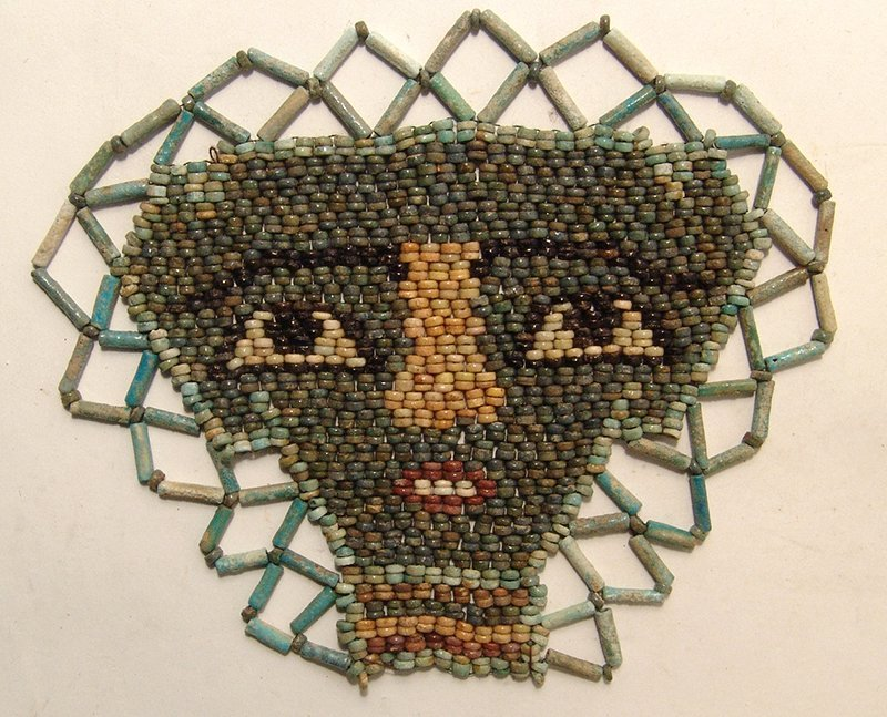 Beautiful Egyptian faience beads shaping a face 'mask