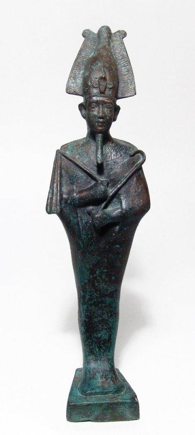 A large and impressive Egyptian bronze figure of Osiris