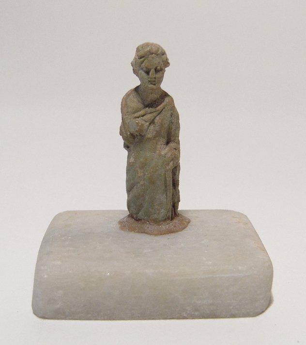 A choice Roman bone figure of a woman