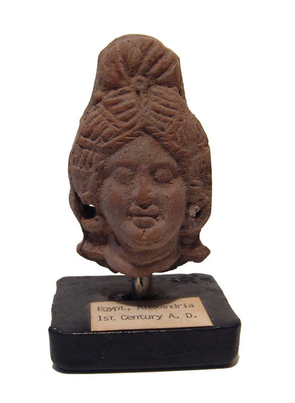 An Egyptian terracotta head of a woman, Alexandria