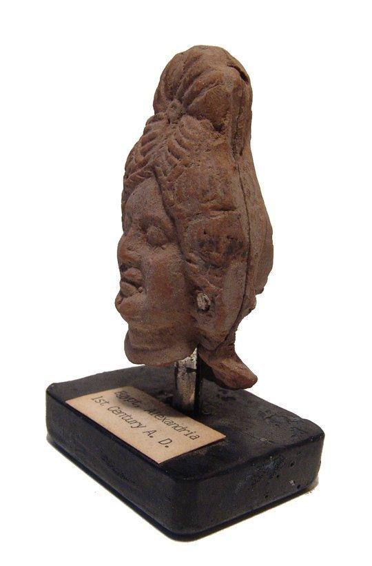An Egyptian terracotta head of a woman, Alexandria - 2