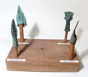 A group of 4 ancient tools and weapons
