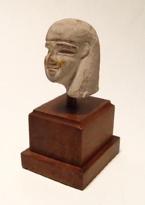 An Egyptian gilded limestone head of a ushabti