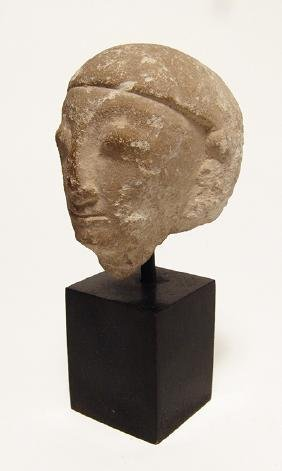 Levantine limestone head of man, possibly a Pharaoh