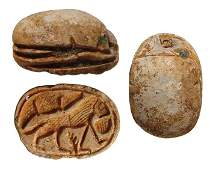 An attractive Egyptian steatite scarab with a lion