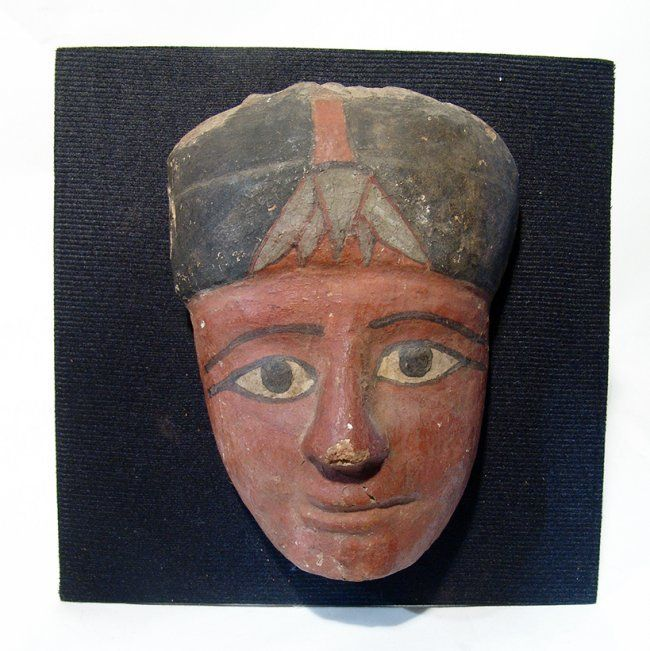 A well-preserved Egyptian wooden 'mummy' mask'