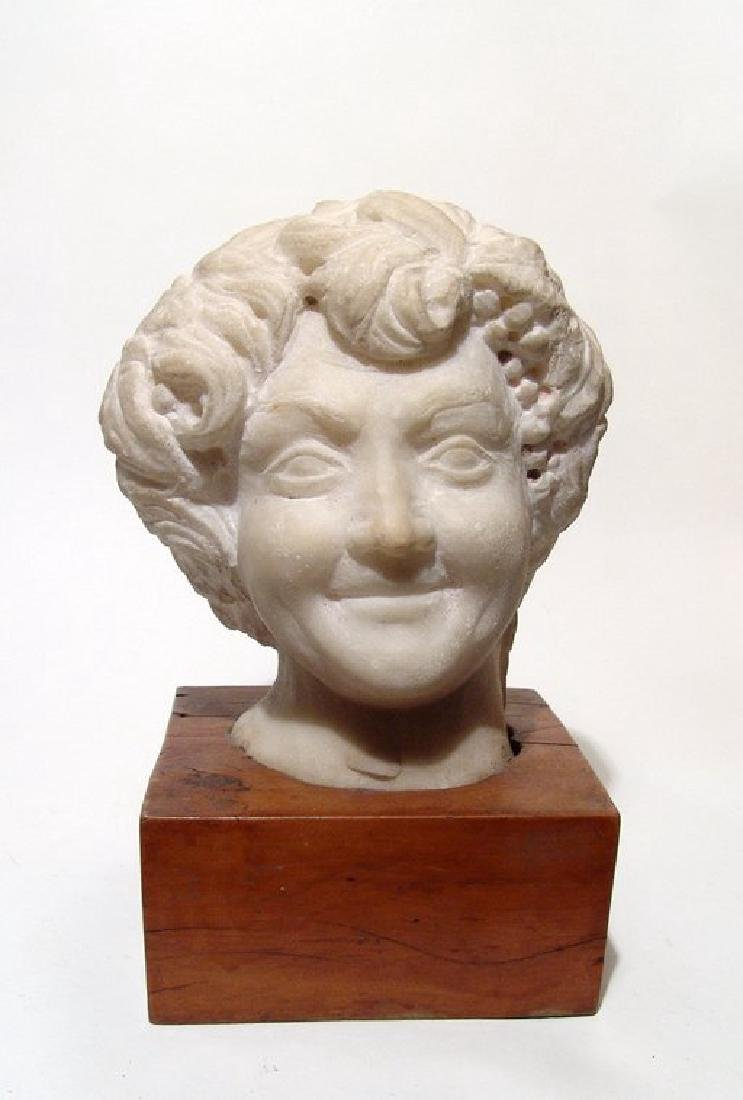 A Roman marble head of youthful Bacchus