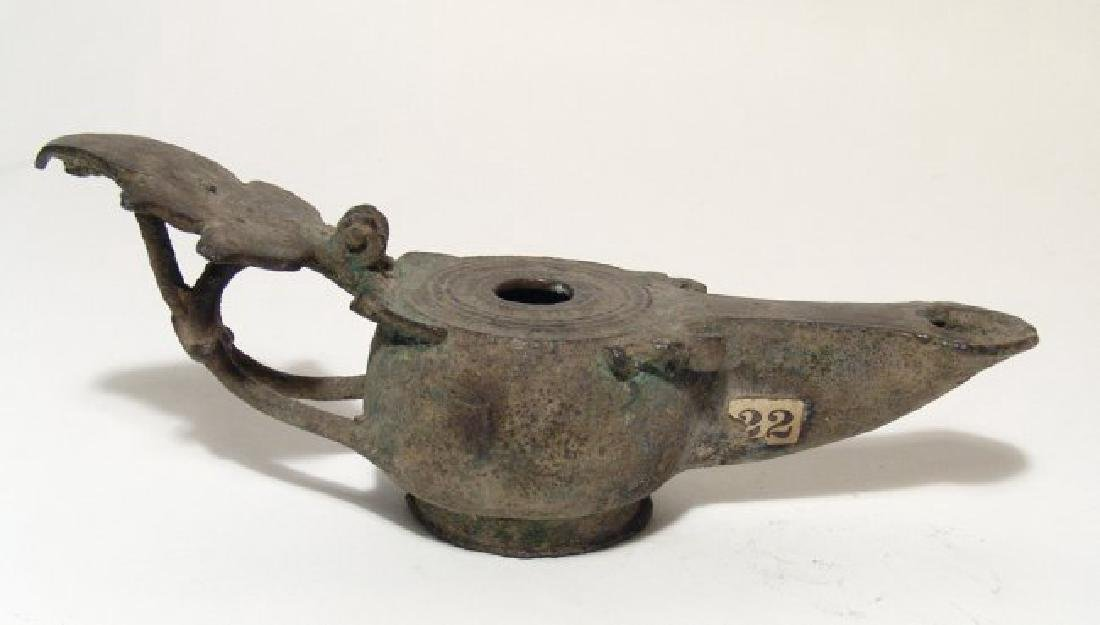 A fantastic Roman Republican bronze oil lamp