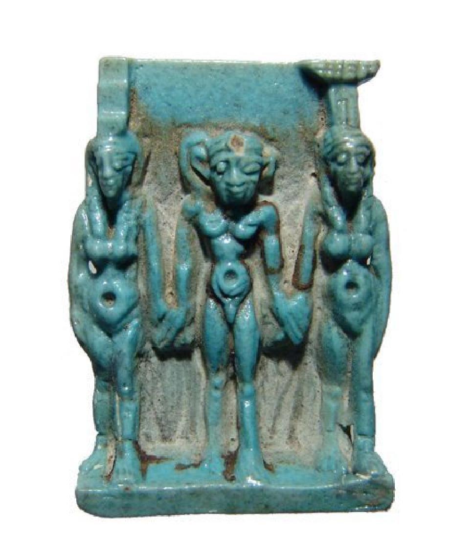 A stunning Egyptian light blue faience Triad amulet
