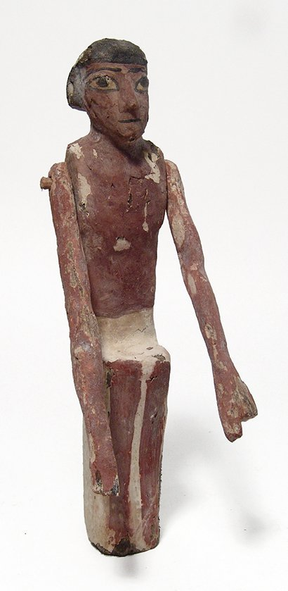 An Egyptian wooden figure, Middle Kingdom