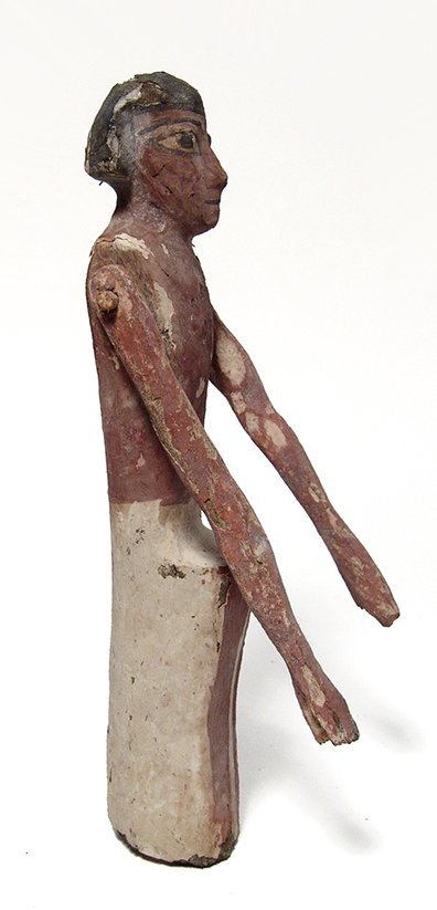 An Egyptian wooden figure, Middle Kingdom - 2