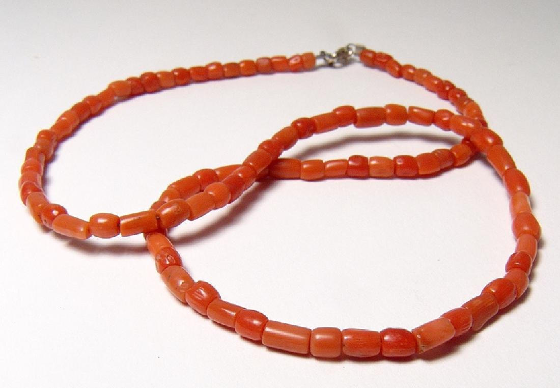A strand of Romano-Egyptian orange coral beads