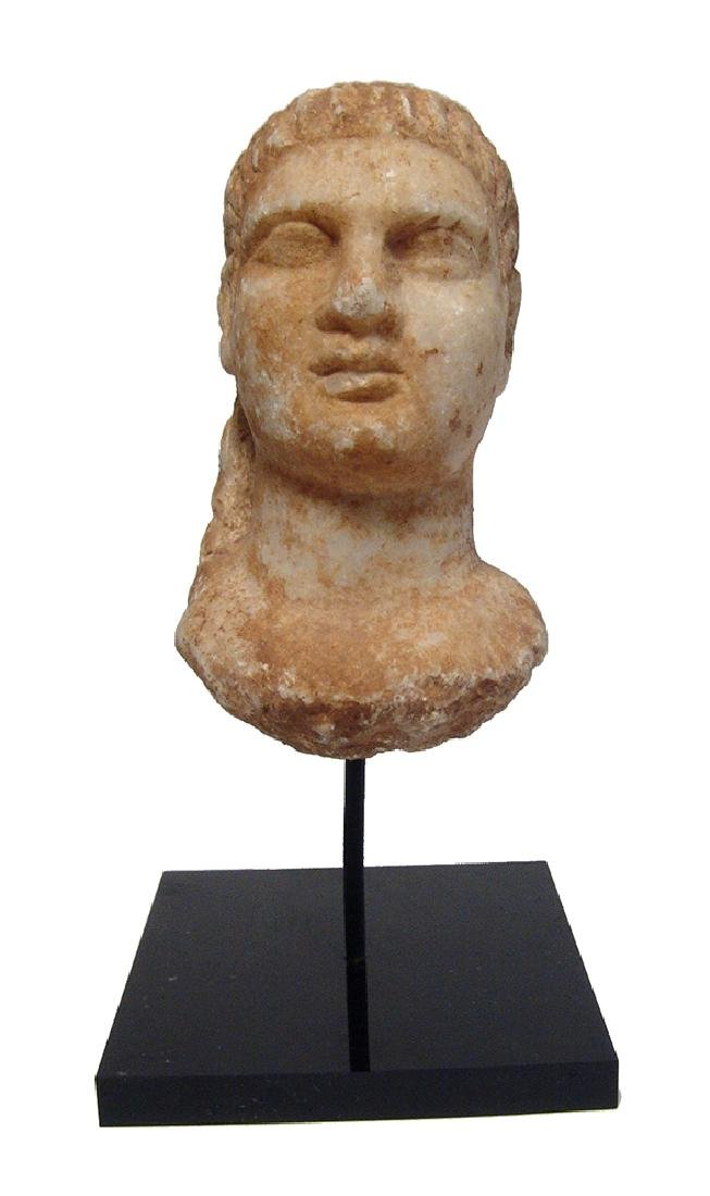 A well-detailed Roman marble head of a man