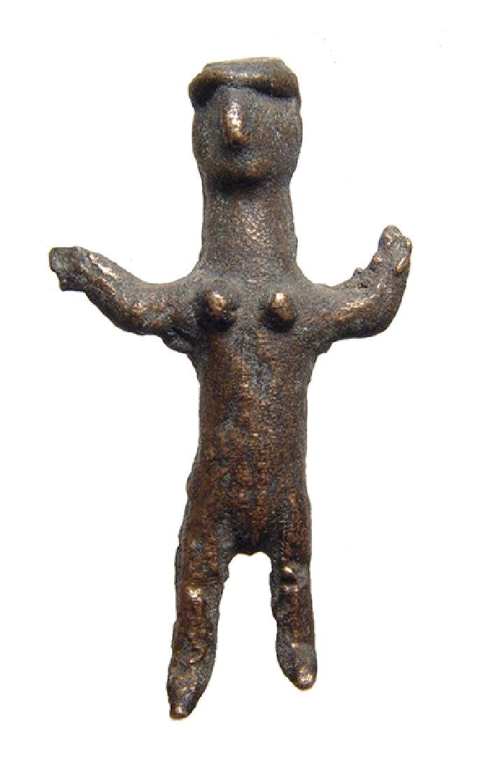 A Near Eastern bronze female figurine