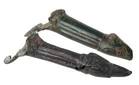 A pair of Roman bronze patera handles