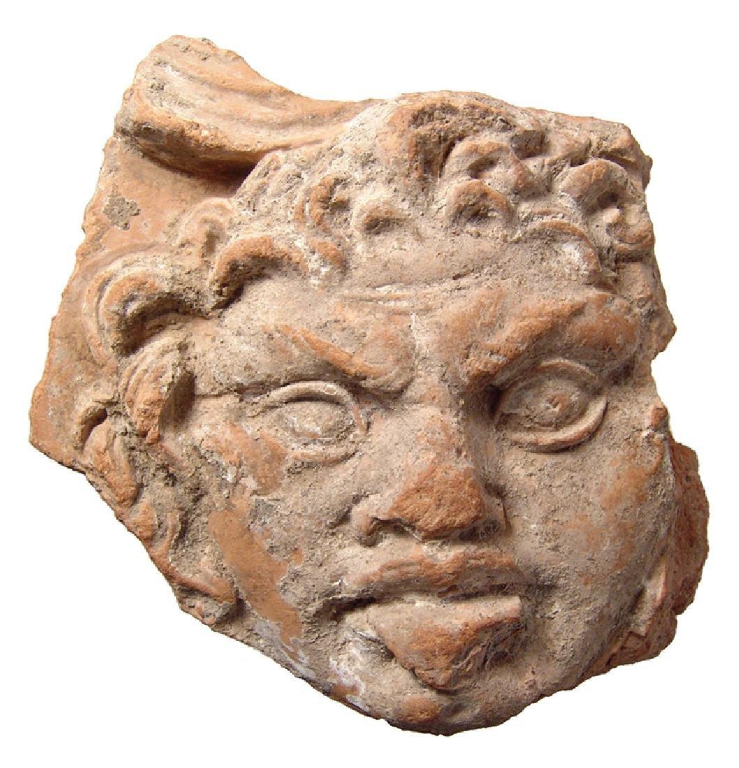 Roman terracotta antefix fragment depicting Silenus