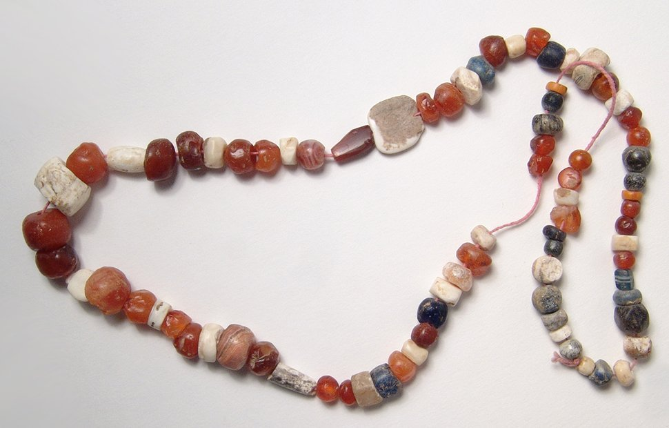 A strand of mixed ancient stone and shell beads
