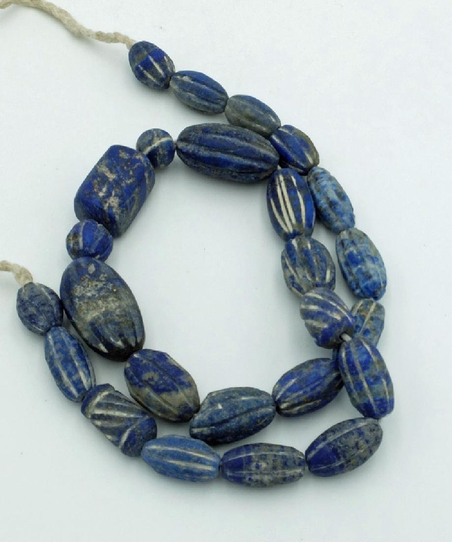 A strand of finely carved Islamic stone beads