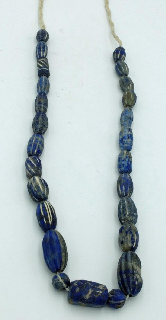 A strand of finely carved Islamic stone beads - 2