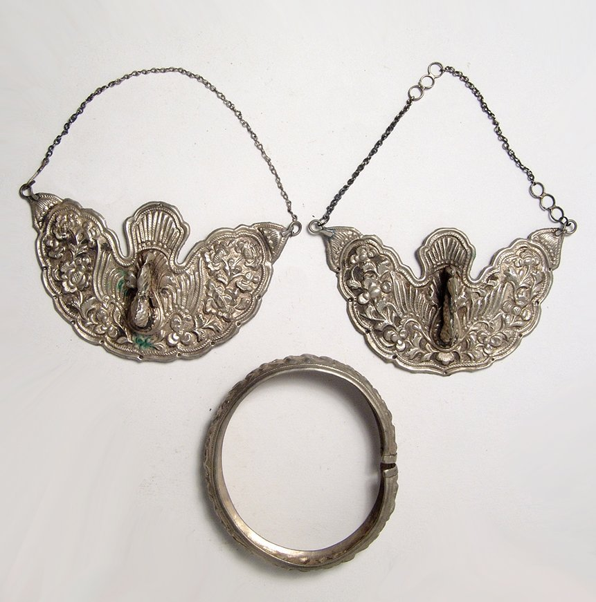 A pair of antique silver earrings and a bracelet