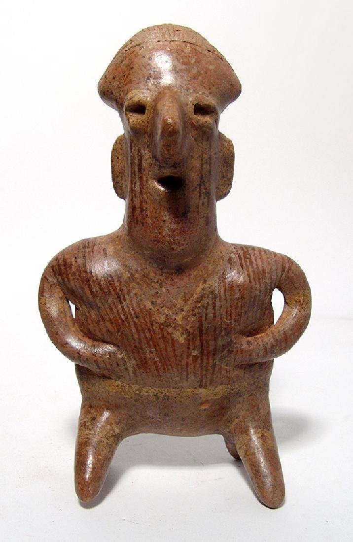 An attractive Nayarit kneeling male figure