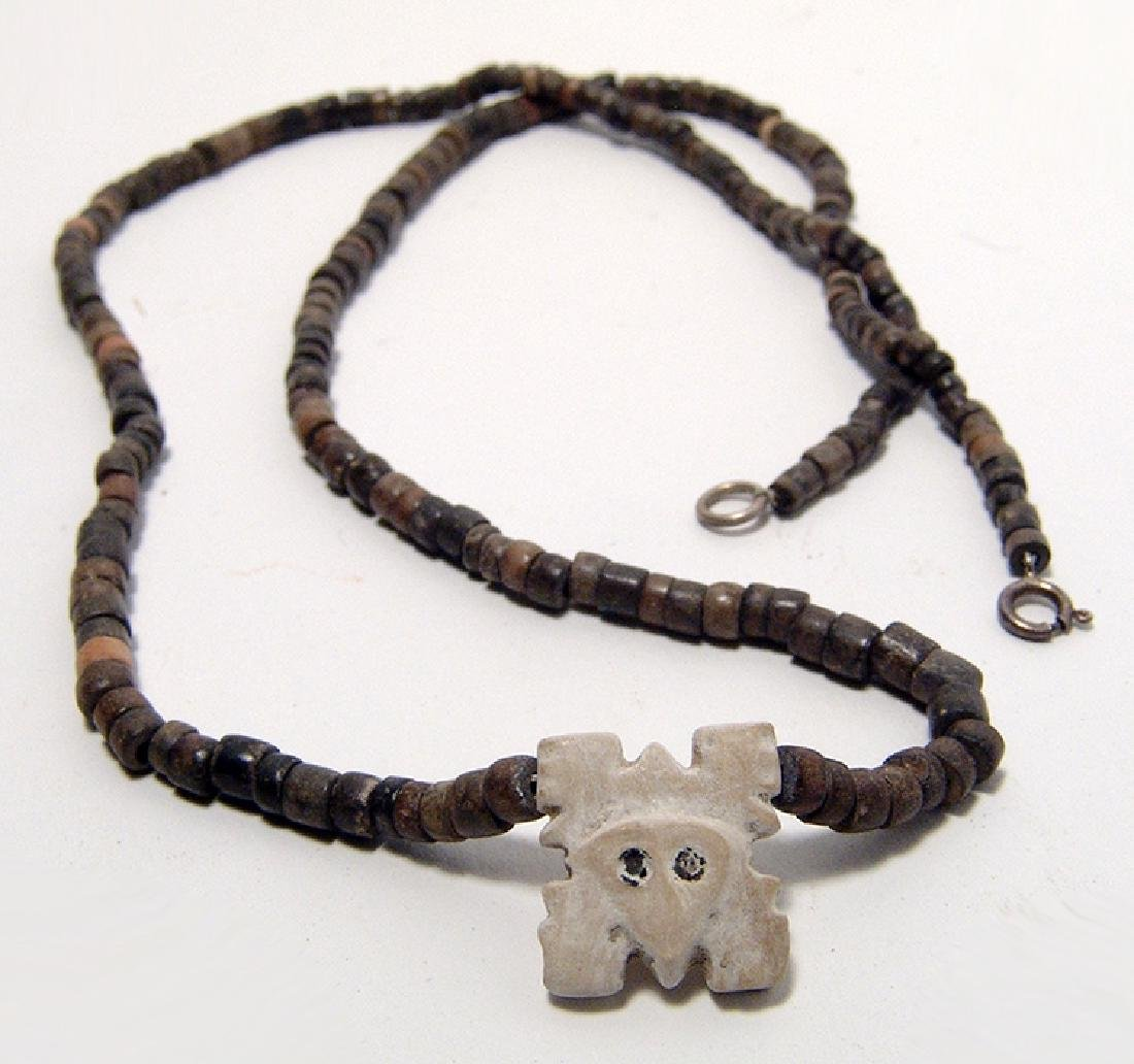 A Chimu beaded necklace with shell pendant