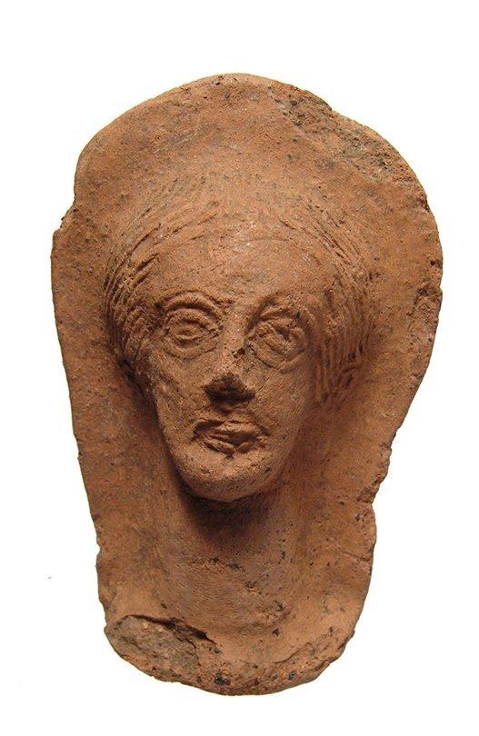 An Etruscan terracotta votive of a female head