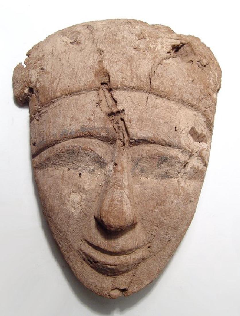 A large Egyptian wooden mummy mask, Late Period