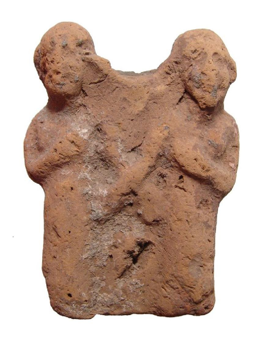 An Egyptian terracotta group depicting two figures
