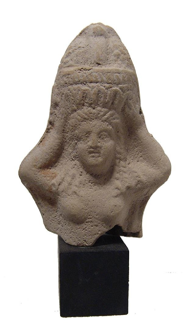 A Roman-Egyptian terracotta bust of a woman