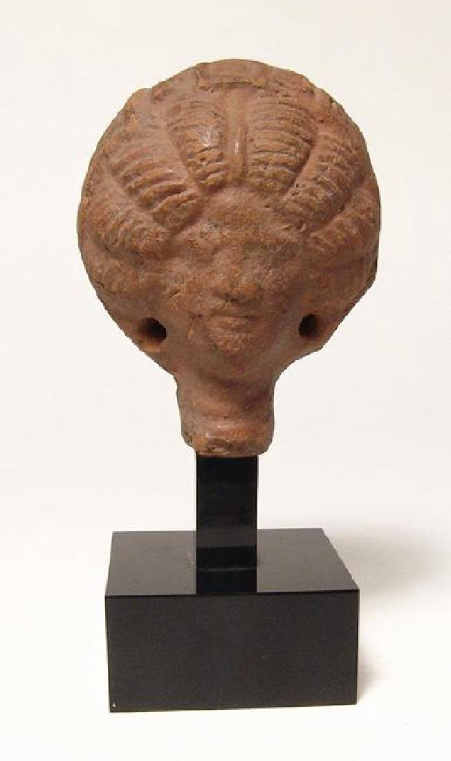 A great Roman terracotta head of a fashionable lady,