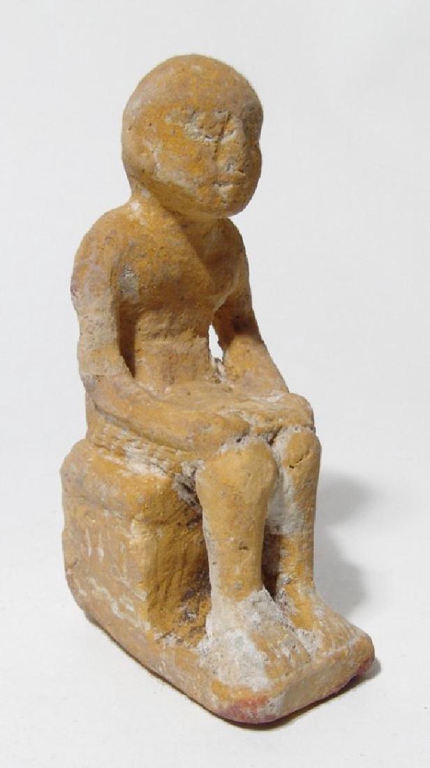 An Egyptian stucco/limestone seated priest