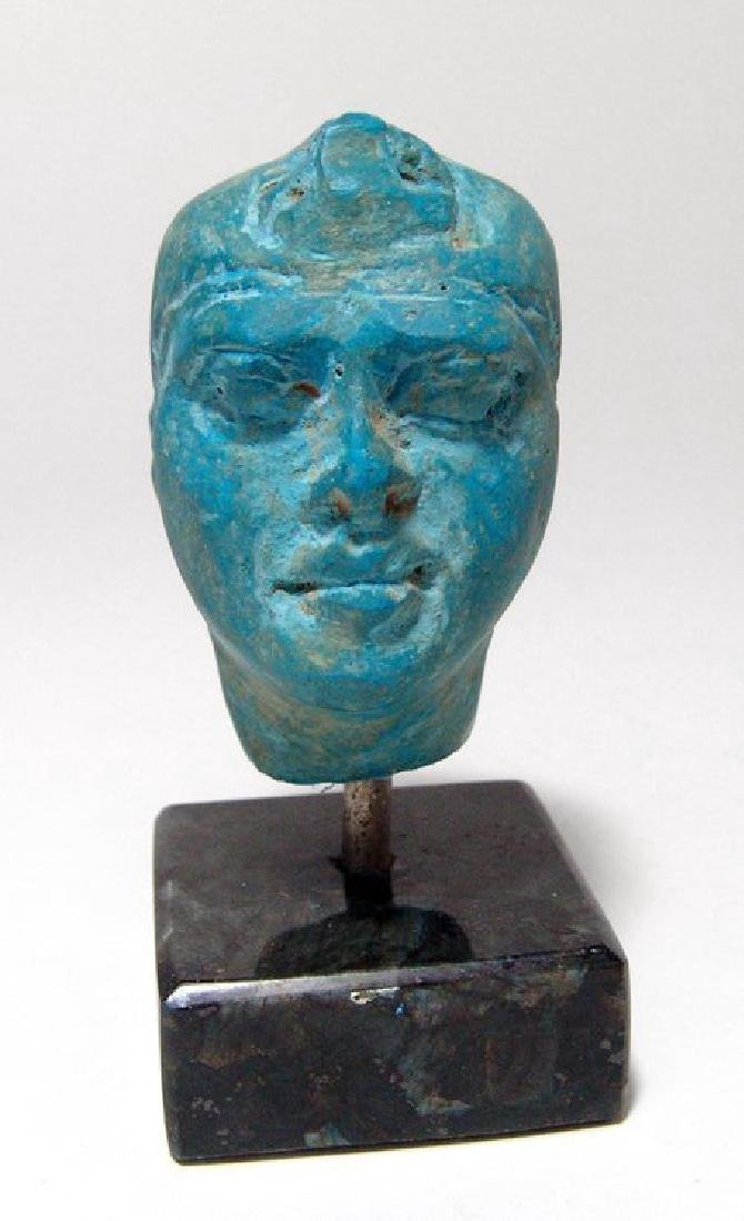 A stunning Egyptian blue composition head of a man