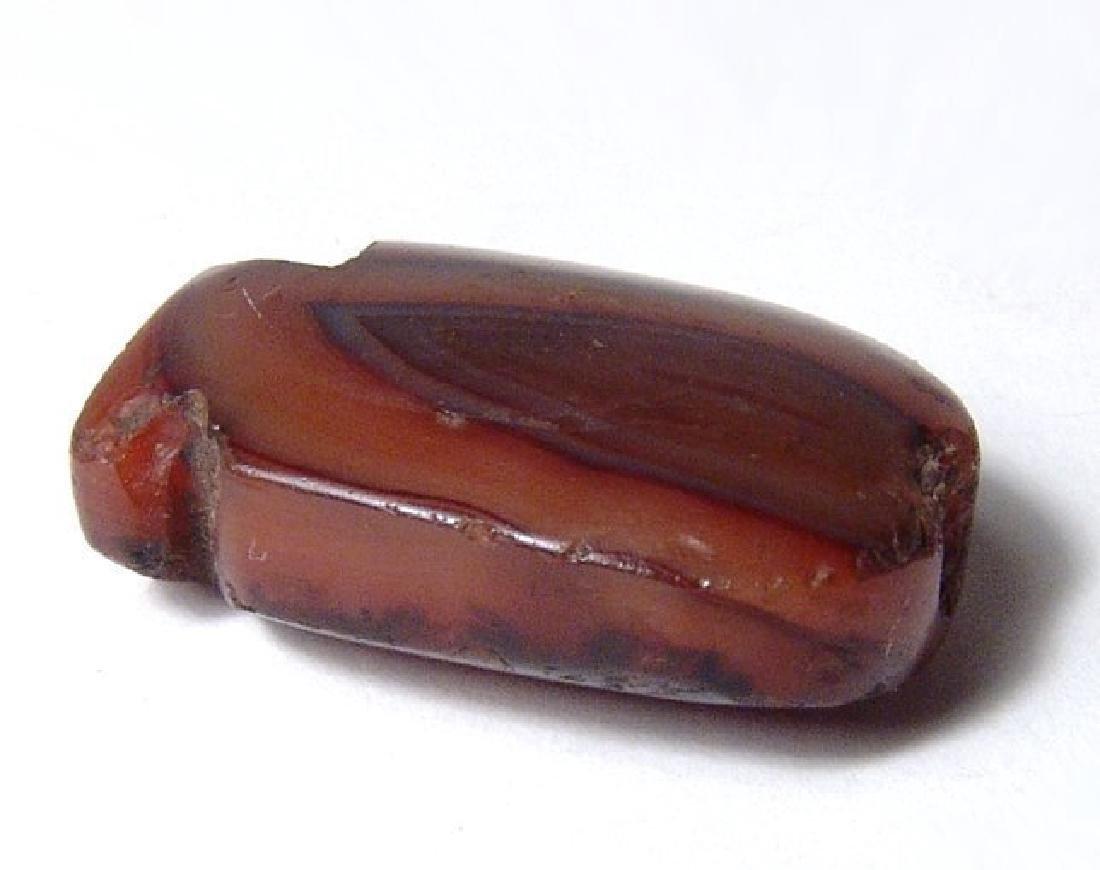 An Egyptian carnelian cartouche-shaped bead - 4