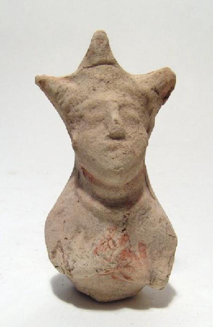 An Eastern Greek terracotta rattle figure of a woman