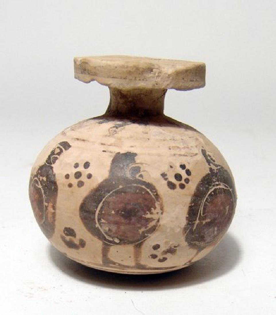 A Corinthian aryballos with stylized warriors