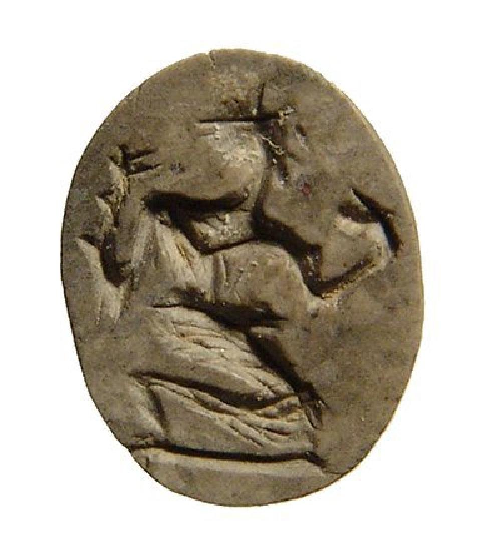 A Roman jasper ring stone depicting a kneeling satyr