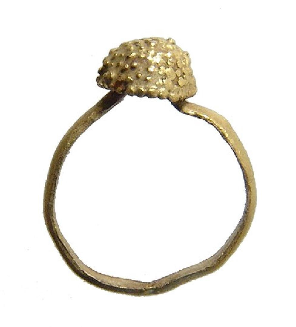 A Roman gold child's ring with a berry-like decoration
