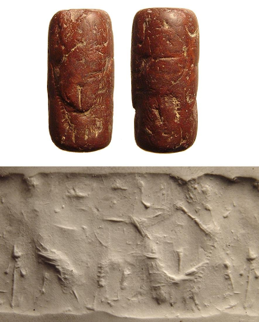A Neo-Assyrian red steatite cylinder seal