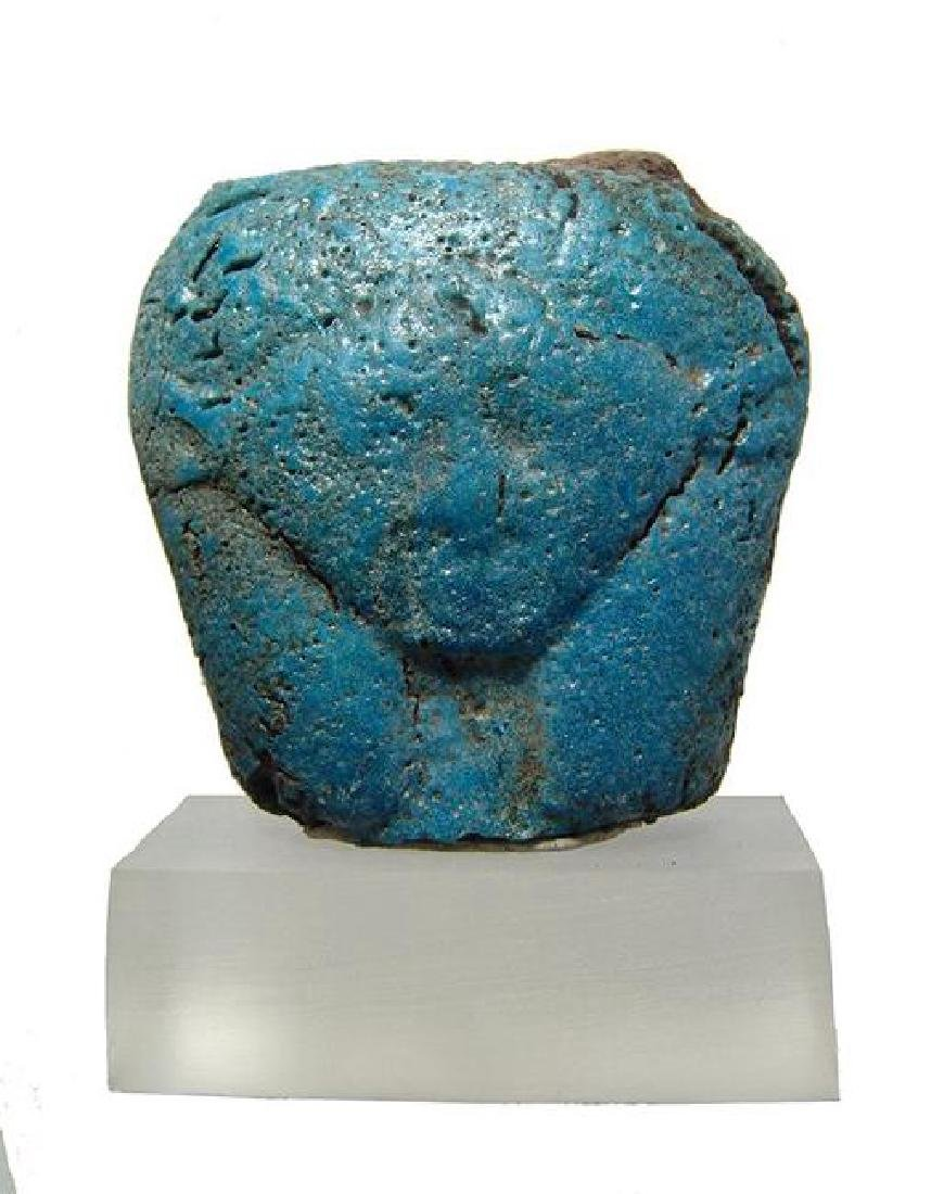 An Egyptian faience turquoise glazed head of Hathor