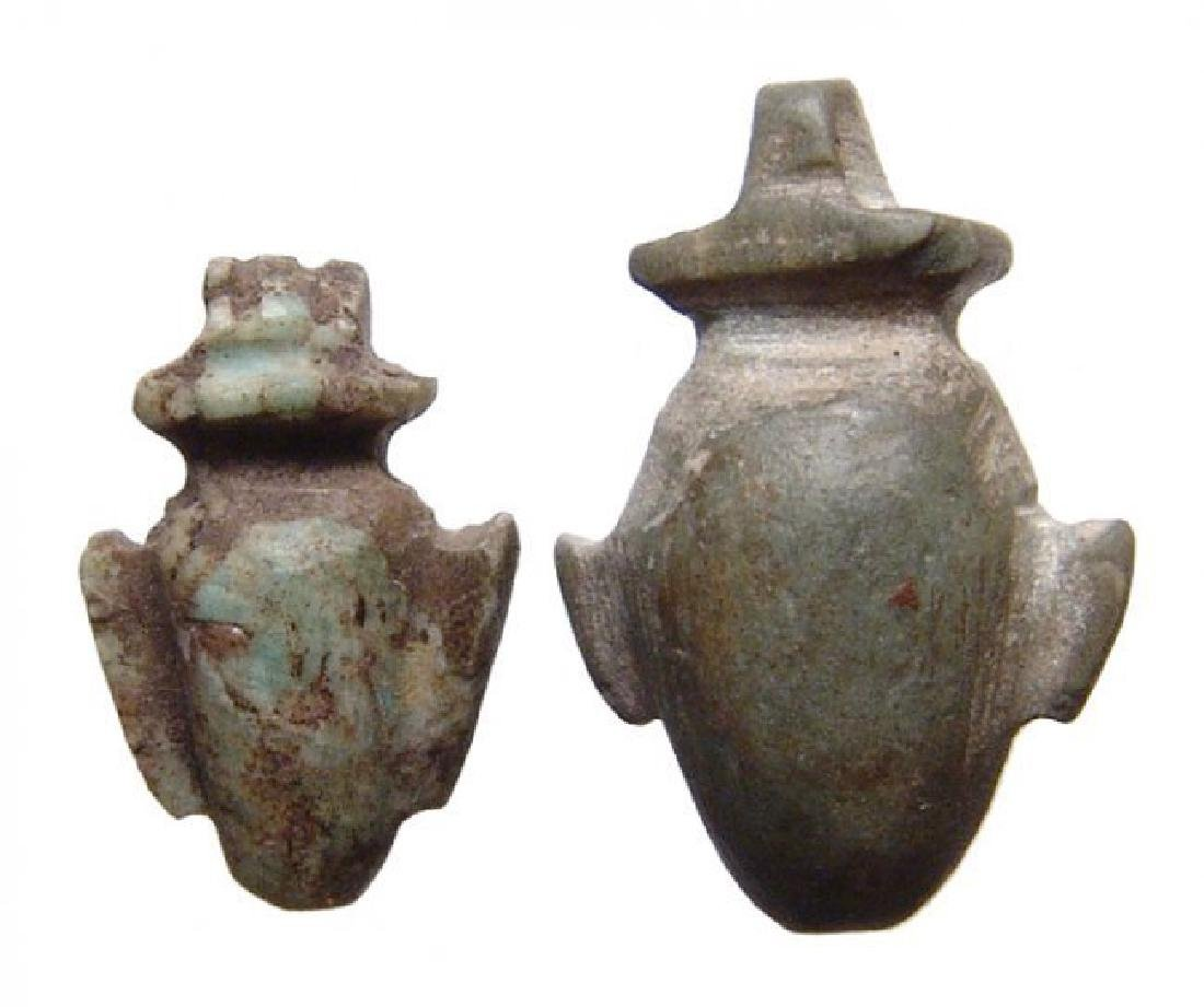 A pair of Egyptian stone 'ib' or heart amulets, Late