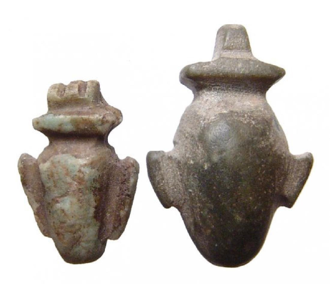 A pair of Egyptian stone 'ib' or heart amulets, Late - 2
