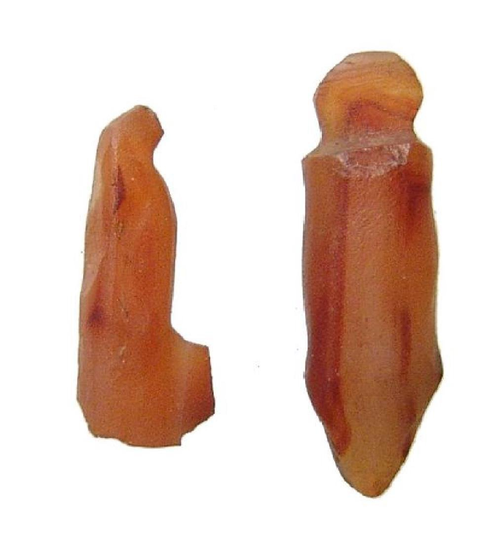 A pair of ancient Egyptian carnelian amulets, Late