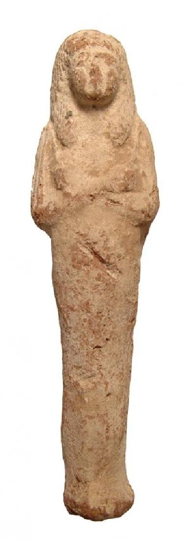 A large Egyptian terracotta ushabti, Late New Kingdom