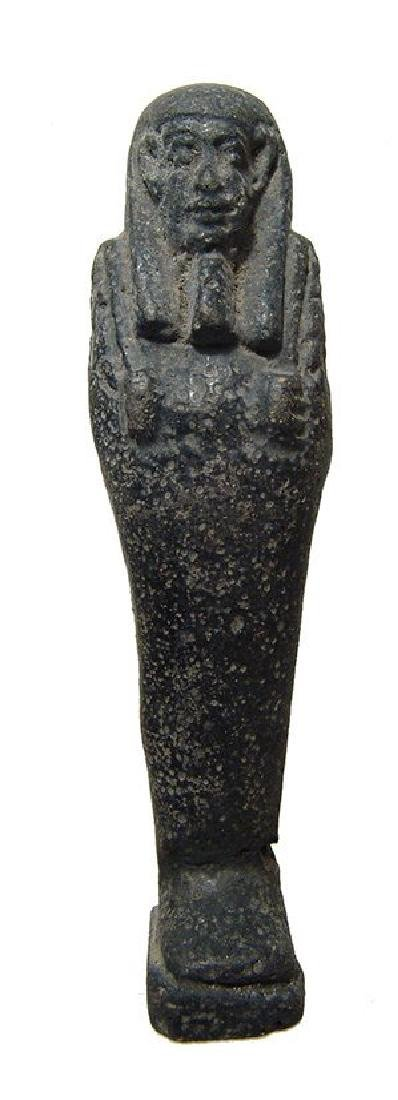 An Egyptian faience ushabti with black glaze, Late
