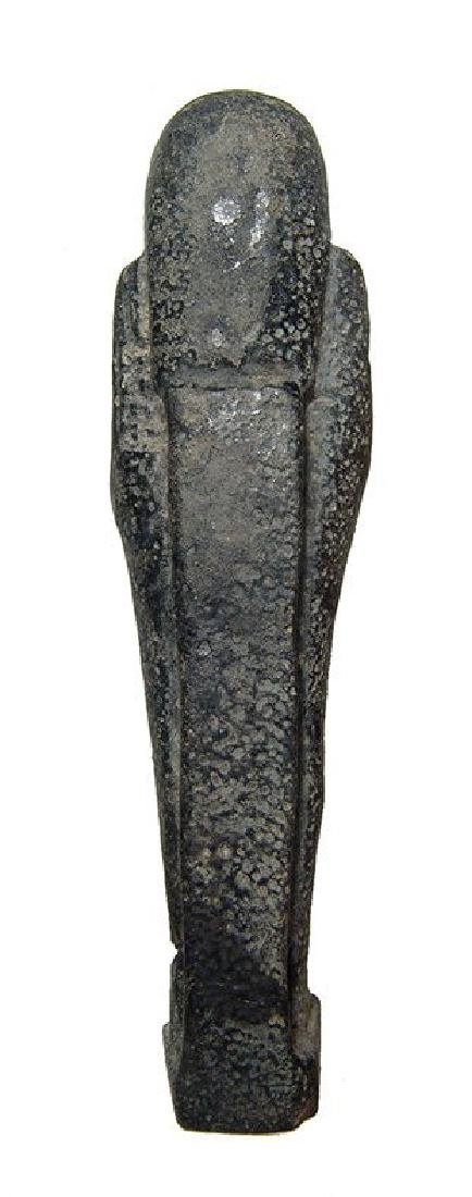 An Egyptian faience ushabti with black glaze, Late - 4