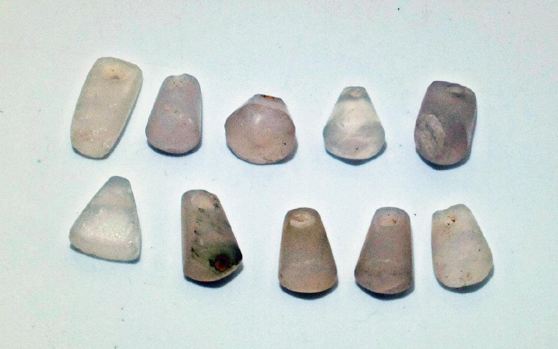 A group of 10 Tairona stone pendants from Colombia