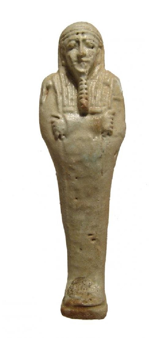 An Egyptian pale green faience ushabti, Late Period